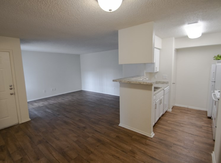 This is a photo of the dining area in a 704 square foot 1 bedroom apartment at The Boulders Apartments in Garland, TX.