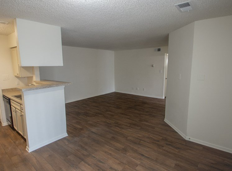 This is a photo of the living room in a 1024 square foot 3 bedroom apartment at The Boulders Apartments in Garland, TX.