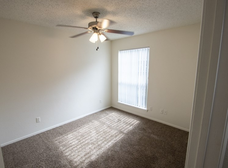 This is a photo of the third bedroom in a 1024 square foot 3 bedroom apartment at The Boulders Apartments in Garland, TX.