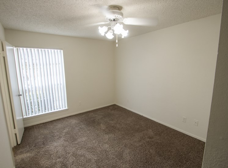 This is a photo of the master bedroom in a 1024 square foot 3 bedroom apartment at The Boulders Apartments in Garland, TX.