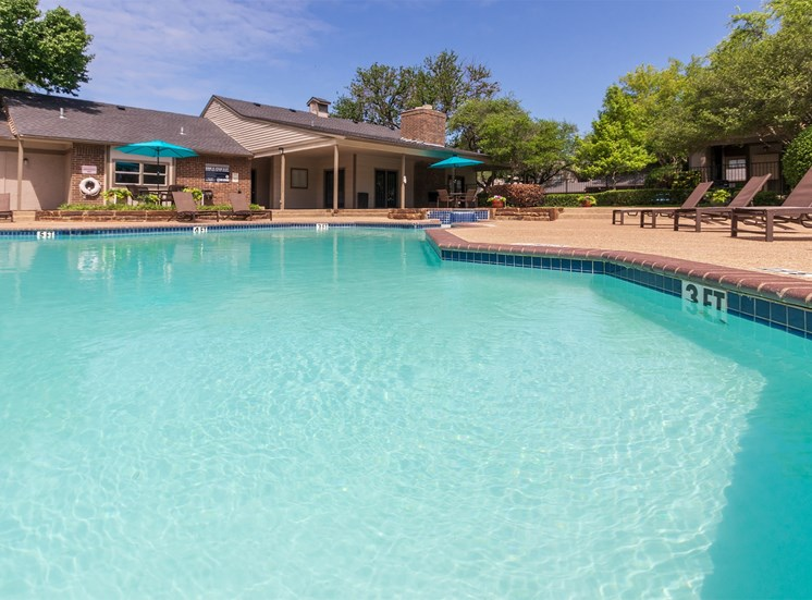 This is a photo of the pool area at The Boulders Apartments in Garland, TX.
