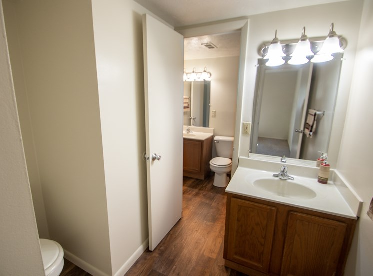 This is a photo of the master half bath in the 899 square foot, 2 bedroom, 1 and a half bath apartment at Blue Grass Manor Apartments in Erlanger, KY.