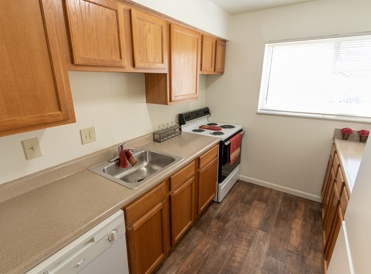 This is a photo of the kitchen in the 899 square foot, 2 bedroom, 1 and a half bath apartment at Blue Grass Manor Apartments in Erlanger, KY.