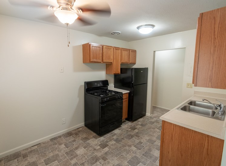 This is a photo of the dining room and kitchen in the 865 square foot, 2 bedroom, 1 and a half bath apartment at Blue Grass Manor Apartments in Erlanger, KY.