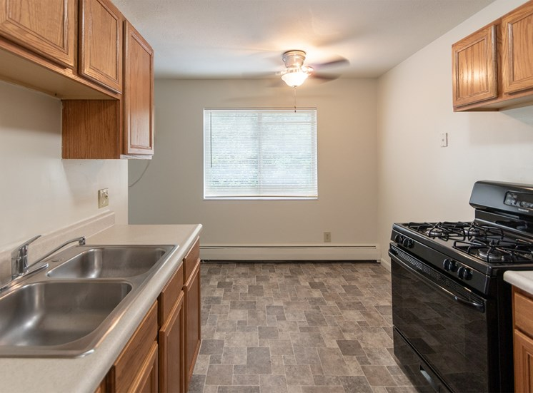 This is a photo of the kitchen and dining room in the 865 square foot, 2 bedroom, 1 and a half bath apartment at Blue Grass Manor Apartments in Erlanger, KY.