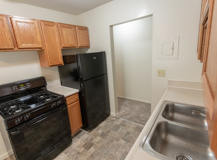 This is a photo of the kitchen in the 865 square foot, 2 bedroom, 1 and a half bath apartment at Blue Grass Manor Apartments in Erlanger, KY.