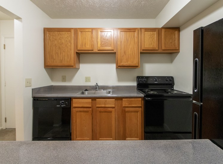 This is a photo of the kitchen of the 902 square foot, 2 bedroom, 1 and a half bath apartment at Blue Grass Manor Apartments in Erlanger, KY.