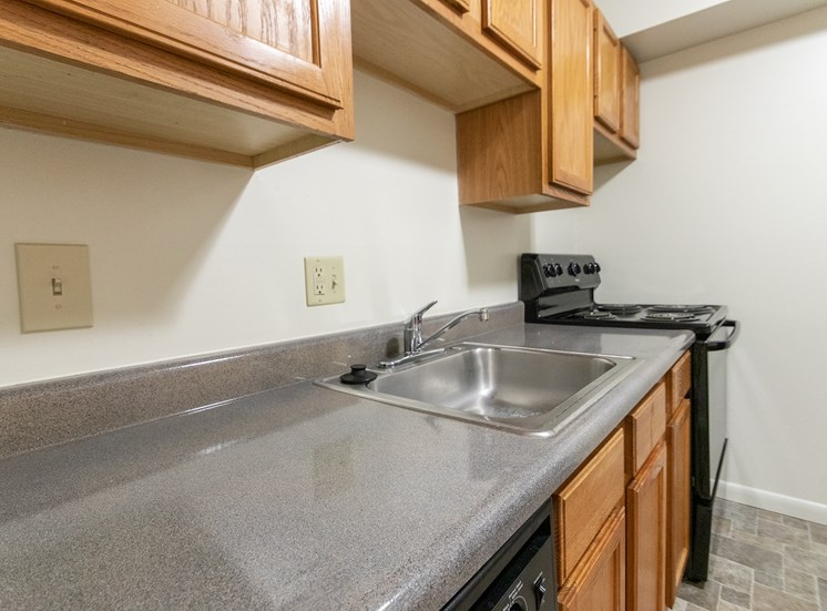 This is a photo of kitchen of the 902 square foot, 2 bedroom, 1 and a half bath apartment at Blue Grass Manor Apartments in Erlanger, KY.