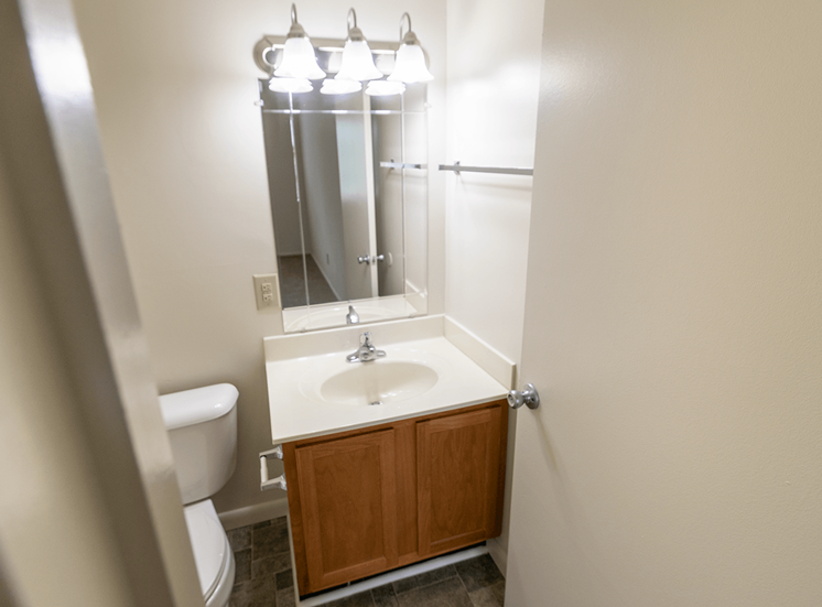 This is a photo of master half bath in the 902 square foot, 2 bedroom, 1 and a half bath apartment at Blue Grass Manor Apartments in Erlanger, KY.