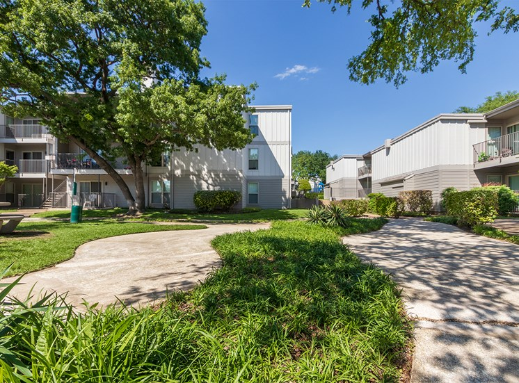 This is a photo of building exteriors and the grounds at The Biltmore Apartments, in Dallas, TX.