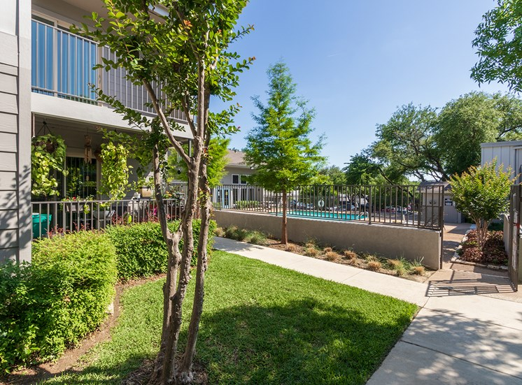 This is a photo of building exteriors and the pool area at The Biltmore Apartments, in Dallas, TX.