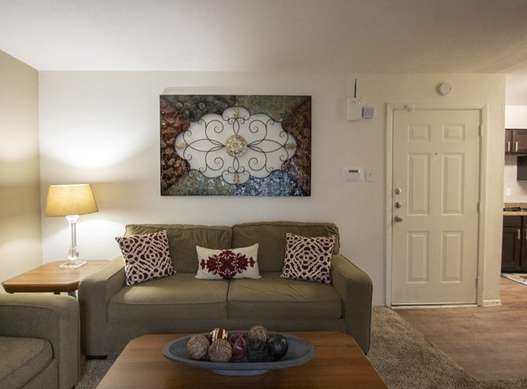 This is a photo of the living room of the 590 square foot 1 bedroom model apartment at The Biltmore Apartments in Dallas, TX.