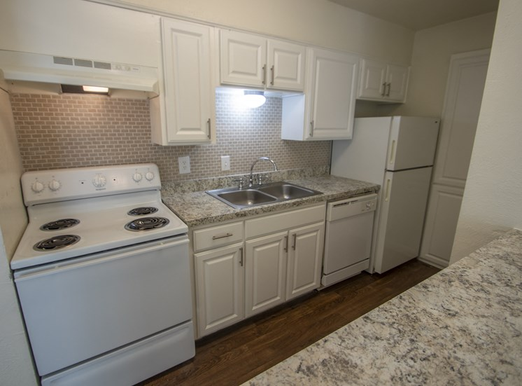 This is a photo of the kitchen of the 752 square foot 1 bedroom apartment with den at The Biltmore Apartments in Dallas, TX.