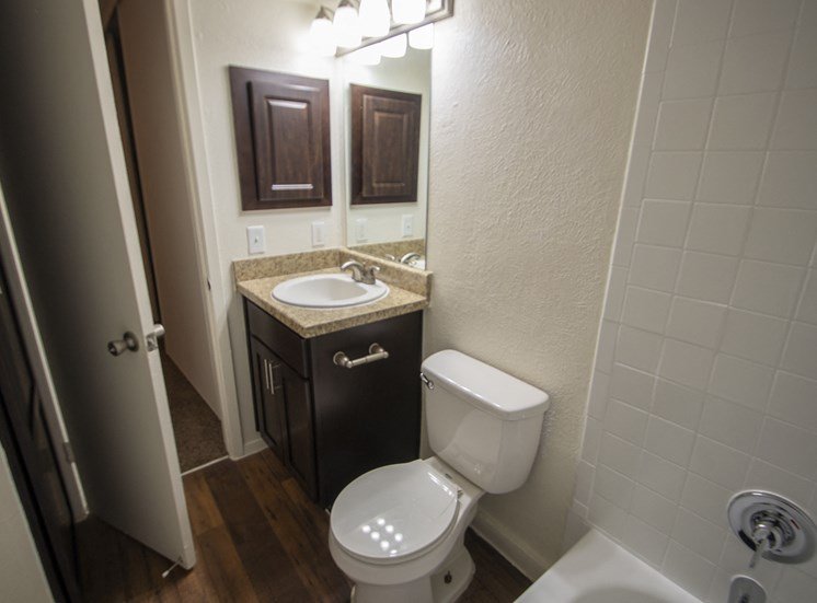 This is a photo of the bathroom of a fully upgraded 554 square foot 1 bedroom apartment at The Biltmore Apartments in Dallas, TX.