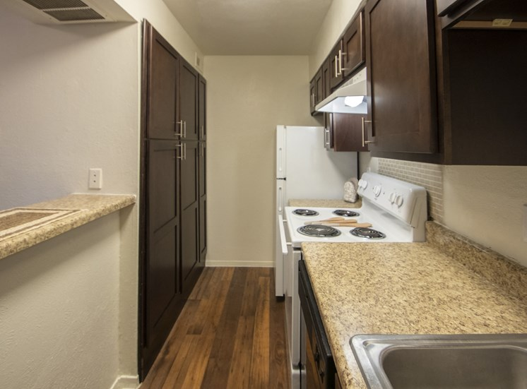 This is a photo of the kitchen of a fully upgraded 554 square foot 1 bedroom apartment at The Biltmore Apartments in Dallas, TX.