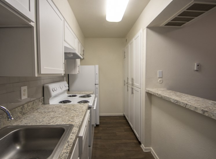 This is a photo of the kitchen of an upgraded 554 square foot 1 bedroom apartment at The Biltmore Apartments in Dallas, TX.