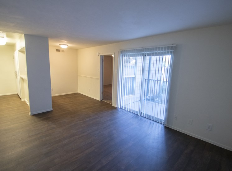 This is a photo of the living room of an upgraded 554 square foot 1 bedroom apartment at The Biltmore Apartments in Dallas, TX.