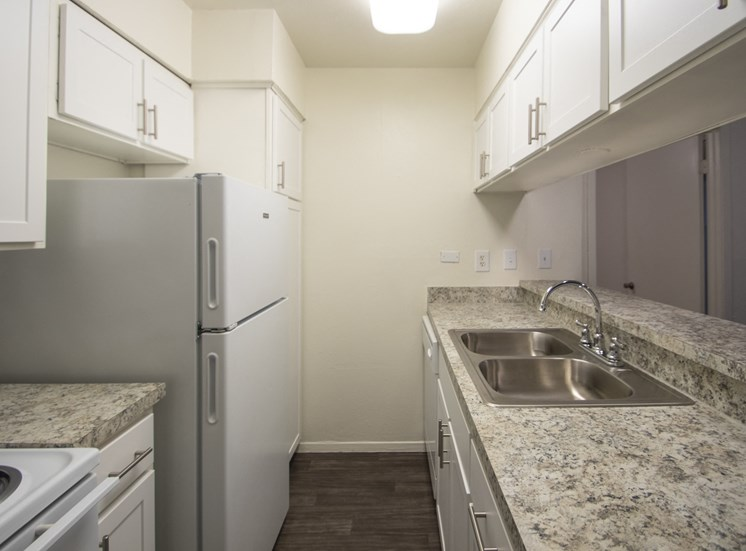 This is a photo of the kitchen of the 864 square foot 2 bedroom apartment at The Biltmore Apartments in Dallas, TX.