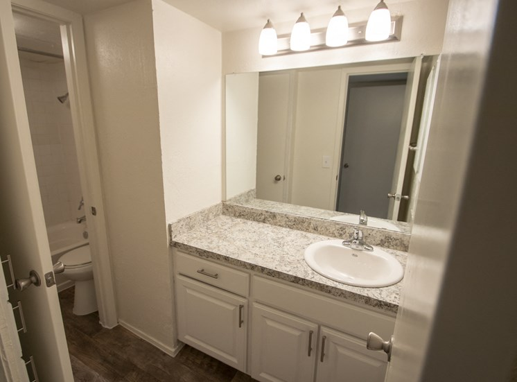 This is a photo of the bathroom of the 1084 square foot 2 bedroom townhome at The Biltmore Apartments in Dallas, TX.