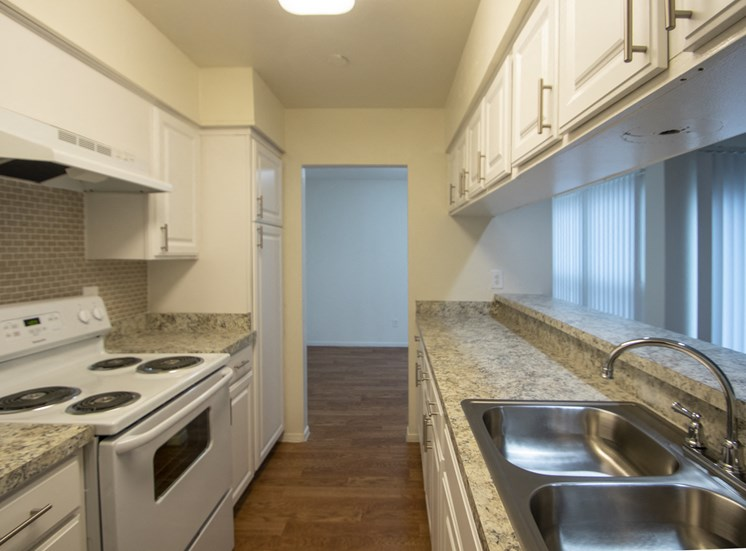 This is a photo of the kitchen of the 1084 square foot 2 bedroom townhome at The Biltmore Apartments in Dallas, TX.