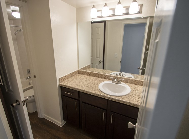 This is a photo of the bathroom of a fully upgraded 1084 square foot 2 bedroom townhome at The Biltmore Apartments in Dallas, TX.