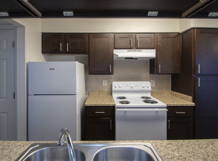 This is a photo of the kitchen of a fully upgraded 1084 square foot 2 bedroom townhome at The Biltmore Apartments in Dallas, TX.