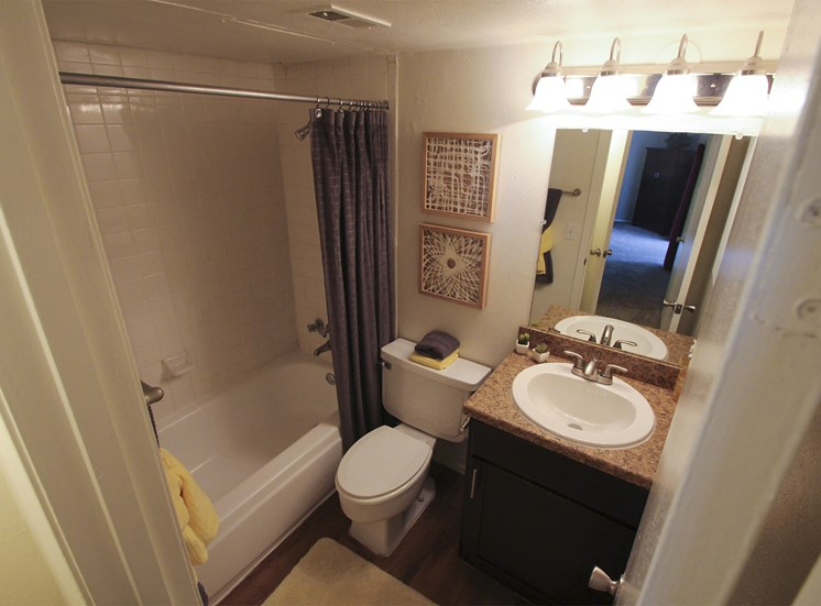 This is a photo of the bathroom of the 590 square foot 1 bedroom model apartment at The Biltmore Apartments in Dallas, TX.