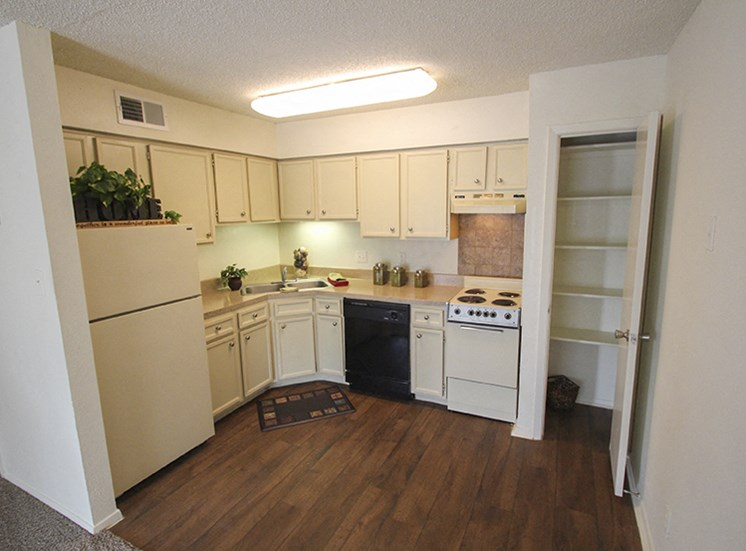 This is a photo of the kitchen of the 507 square foot efficiency apartment at The Boulders Apartments in Garland, TX.