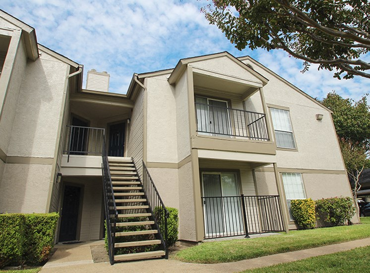 This is a photo of building exteriors at The Boulders Apartments in Garland, TX.