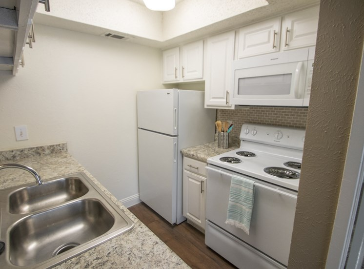 This is a photo of the kitchen of the 515 square foot 1 bedroom apartment at Canyon Creek Apartments in Dallas, TX