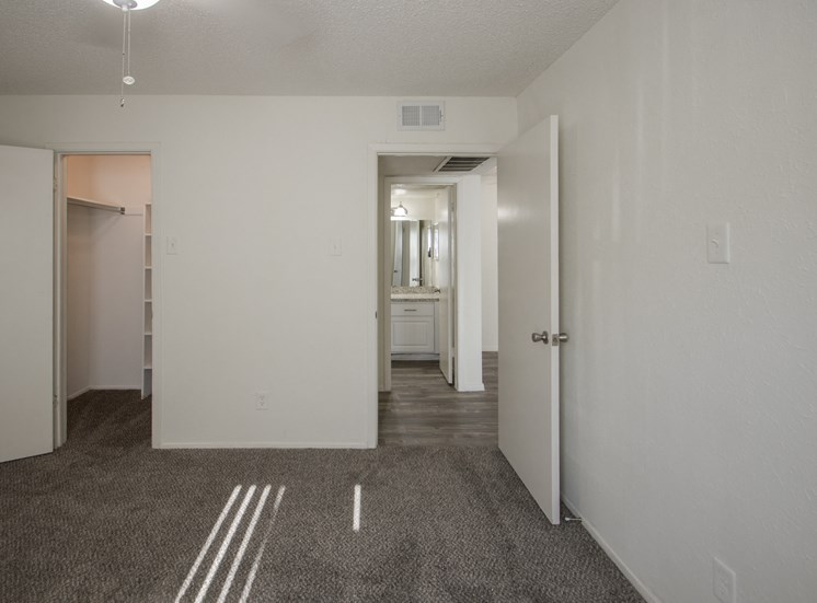 This is a photo of the bedroom of the 550 square foot 1 bedroom apartment at Canyon Creek Apartments in Dallas, TX