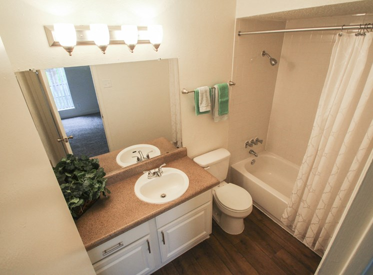 This is a photo of the master bathroom of the 880 square foot 2 bedroom apartment at Canyon Creek Apartments in Dallas, TX