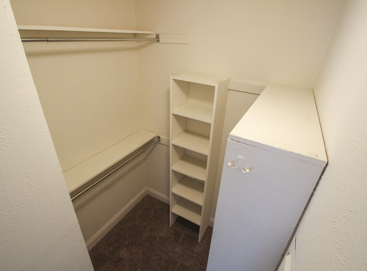 This is a photo of the second bedroom walk-in closet of the 880 square foot 2 bedroom apartment at Canyon Creek Apartments in Dallas, TX
