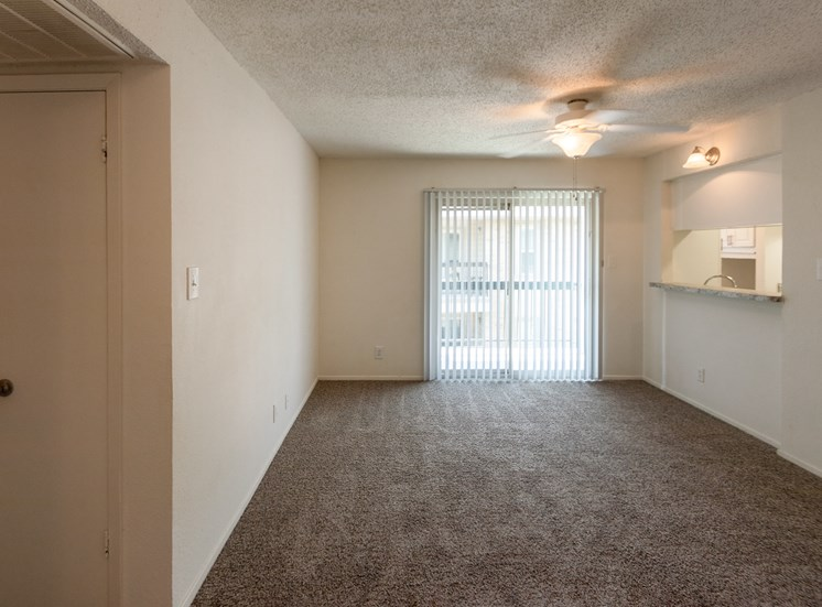 This is a photo of the living room in the 870 square foot 2 bedroom apartment at Gateway Place Apartments in Garland, TX.