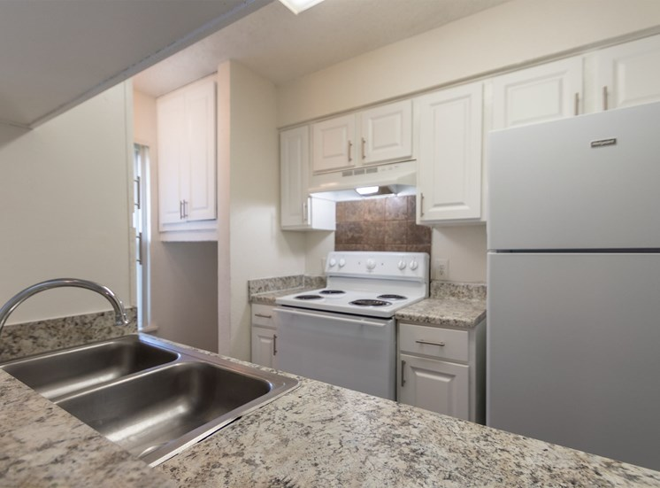 This is a photo of the kitchen in the 870 square foot 2 bedroom apartment at Gateway Place Apartments in Garland, TX.