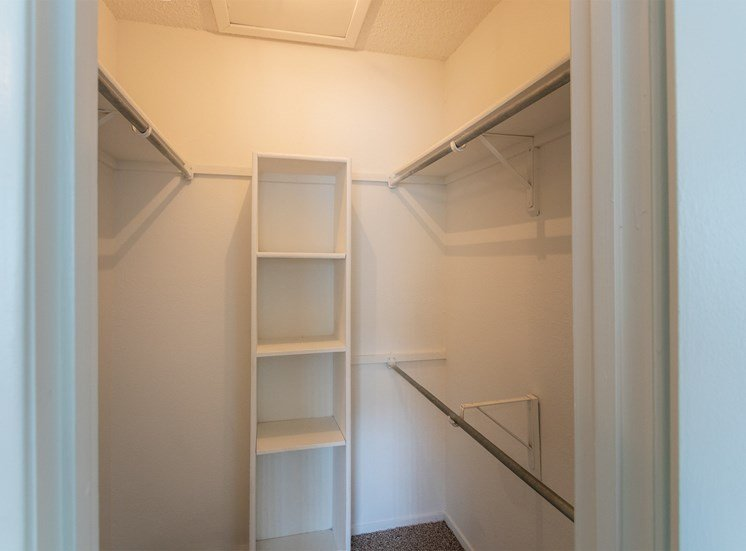 This is a photo of the bedroom walk-in closet in the 870 square foot 2 bedroom apartment at Gateway Place Apartments in Garland, TX.
