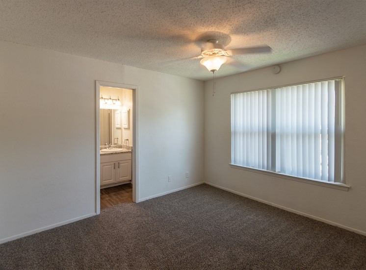 This is a photo of the master bedroom in the 870 square foot 2 bedroom apartment at Gateway Place Apartments in Garland, TX.