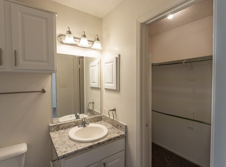 This is a photo of the walk-in closet in the master bathroom in the 870 square foot 2 bedroom apartment at Gateway Place Apartments in Garland, TX.