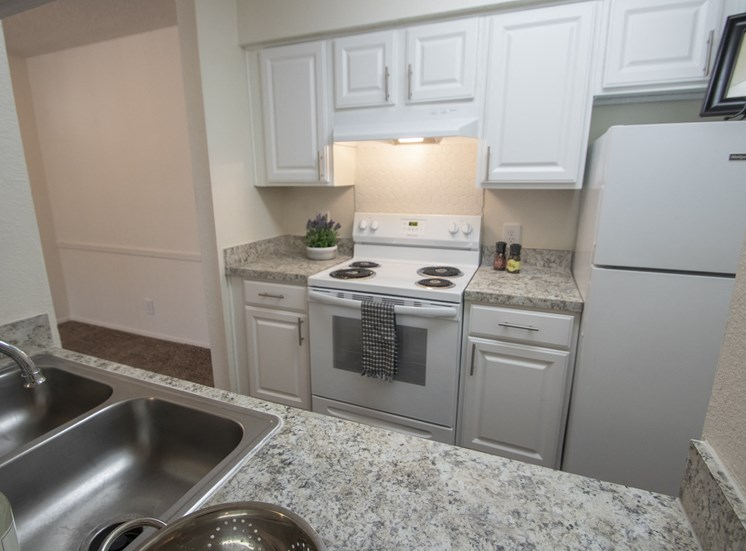 This is a photo of the kitchen in the 690 square foot 1 bedroom apartment at Gateway Place Apartments in Garland, TX.