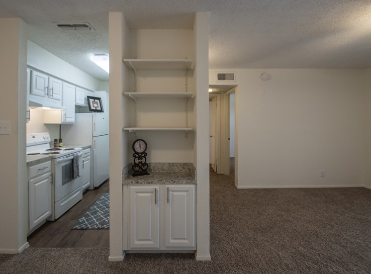 This is a photo of built-in cabinetry in the 690 square foot 1 bedroom apartment at Gateway Place Apartments in Garland, TX.
