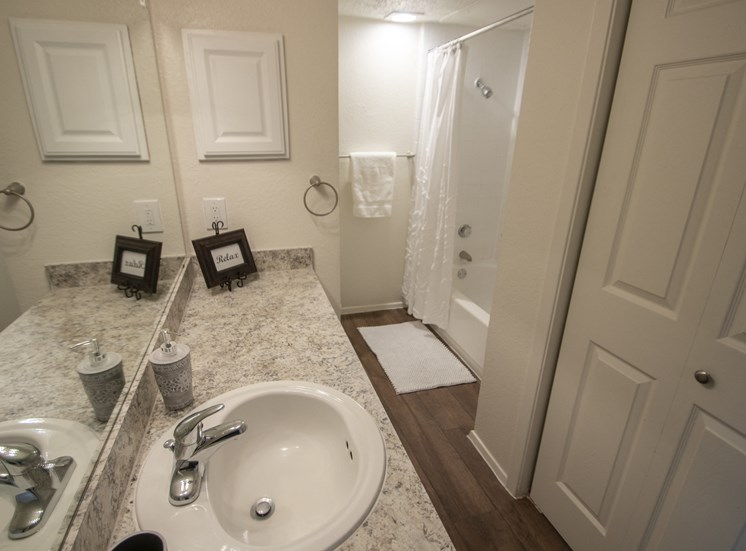 This is a photo of the bathroom and closet which contains the washer & dryer connections in the 690 square foot 1 bedroom apartment at Gateway Place Apartments in Garland, TX.