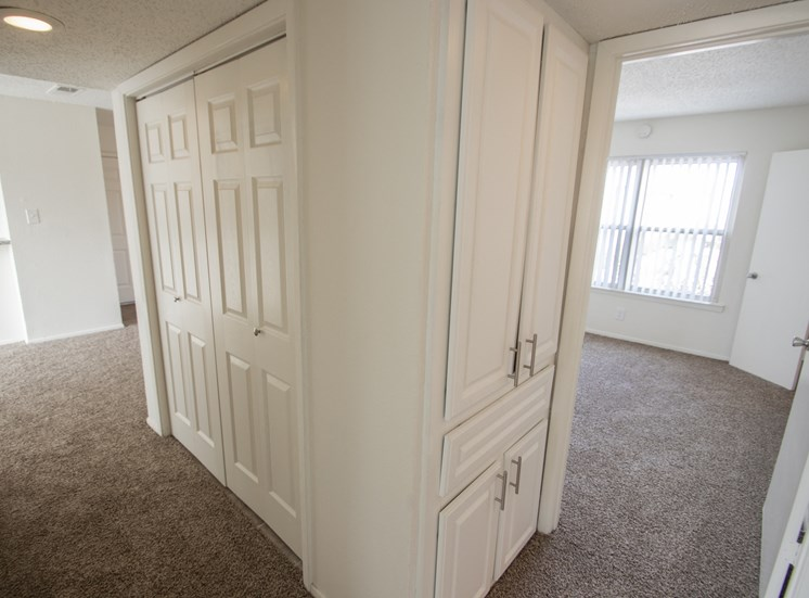 This is a photo of the closet containing the washer and dryer connections and some built in cabinets in the 915 square foot 2 bedroom apartment at Gateway Place Apartments in Garland, TX.