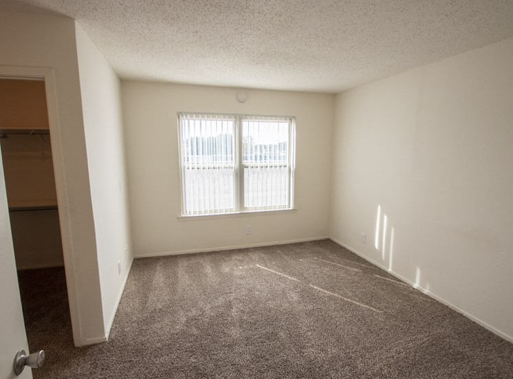 This is a photo of the master bedroom in the 915 square foot 2 bedroom apartment at Gateway Place Apartments in Garland, TX.