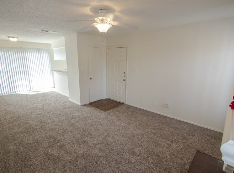This is a photo of the living room and dining area in the 915 square foot 2 bedroom apartment at Gateway Place Apartments in Garland, TX.