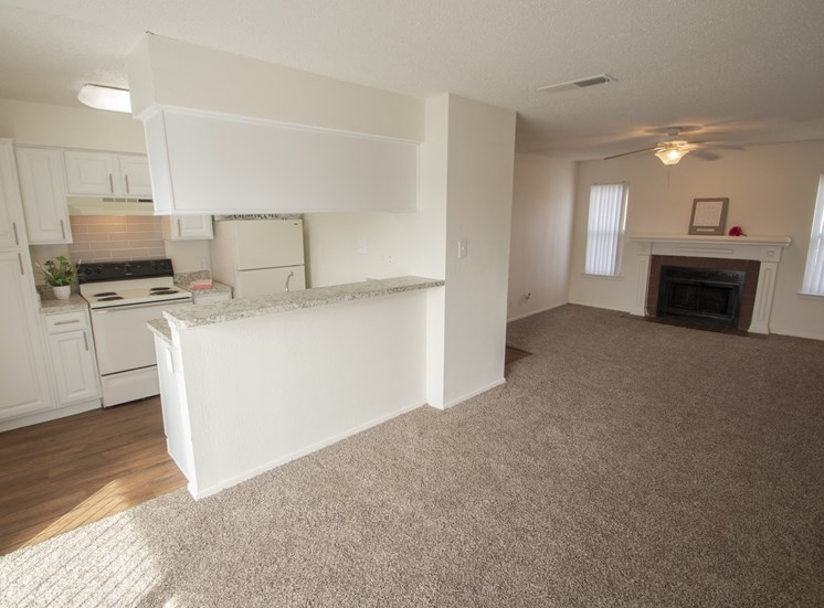 This is a photo of the dining area and living room in the 915 square foot 2 bedroom apartment at Gateway Place Apartments in Garland, TX.