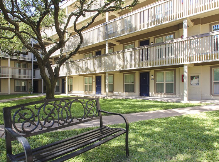 This is a photo of the courtyard at Harvard Square Apartments in Dallas, TX.