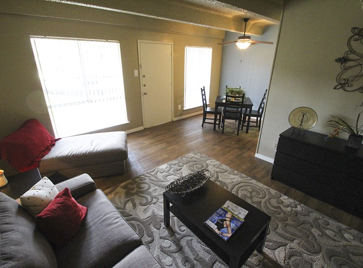 This is a photo of the living room in the 653 square foot 1 bedroom apartment at Harvard Square Apartments, in Dallas, TX.