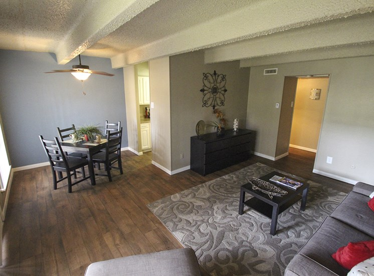 This is a photo of the living room/dining area in the 653 square foot 1 bedroom apartment at Harvard Square Apartments, in Dallas, TX.