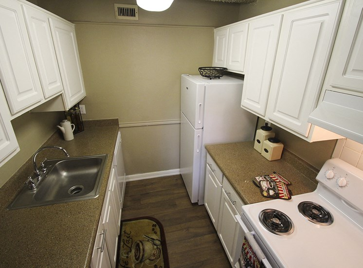 This is a photo of the kitchen in the 653 square foot 1 bedroom apartment at Harvard Square Apartments, in Dallas, TX.