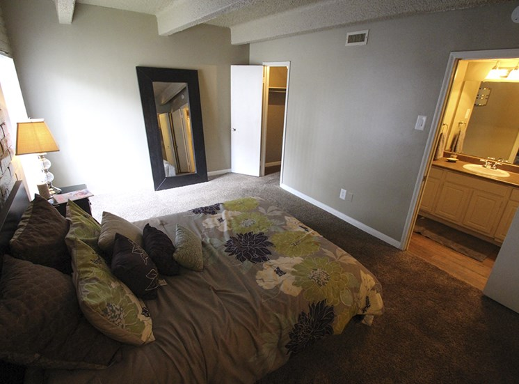 This is a photo of the bedroom in the 653 square foot 1 bedroom apartment at Harvard Square Apartments, in Dallas, TX.